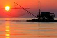 Marina di Pisa - The sun falling in the fishnet